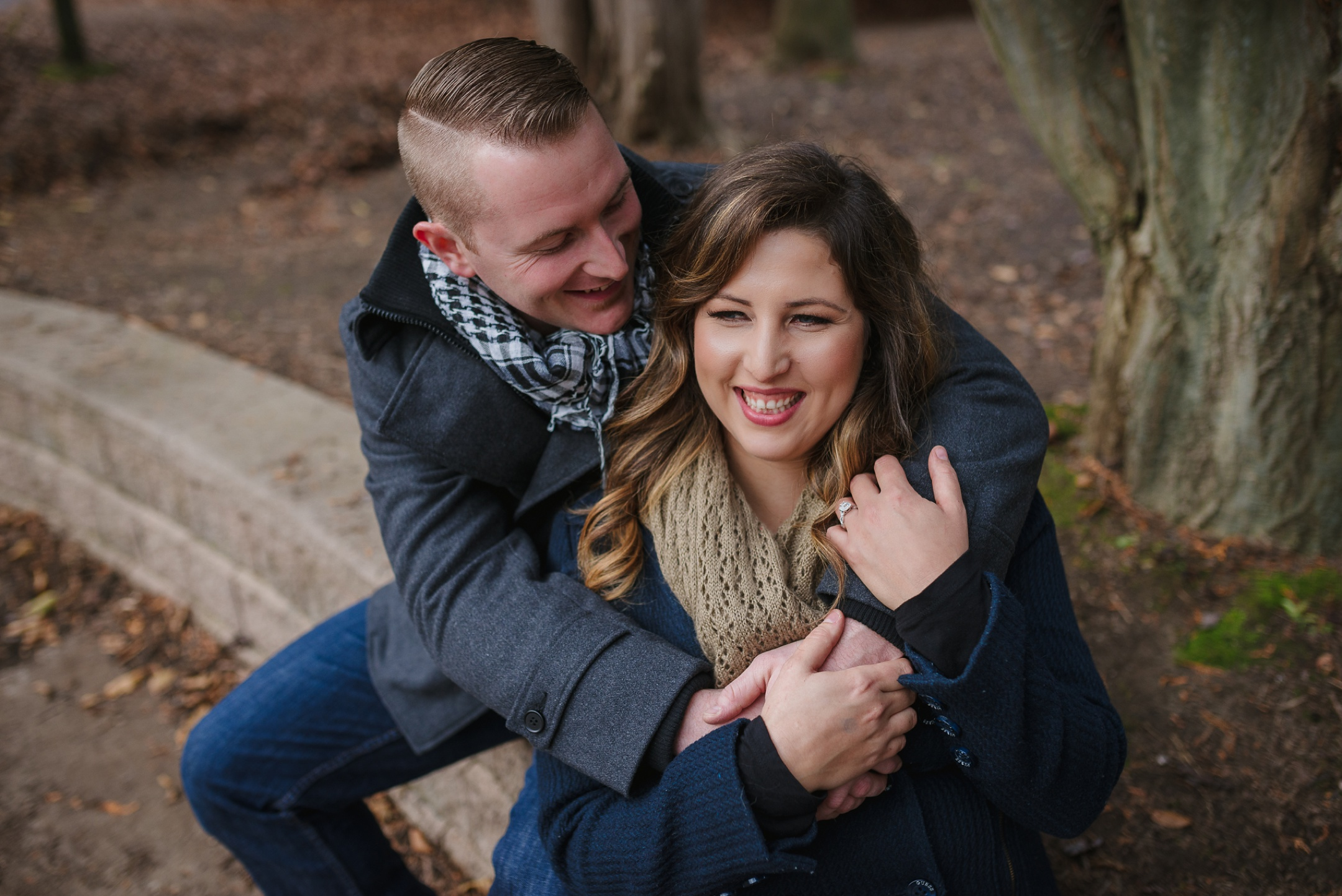 Durham Region, Whitby Engagement Session in the woods, couple sitting together
