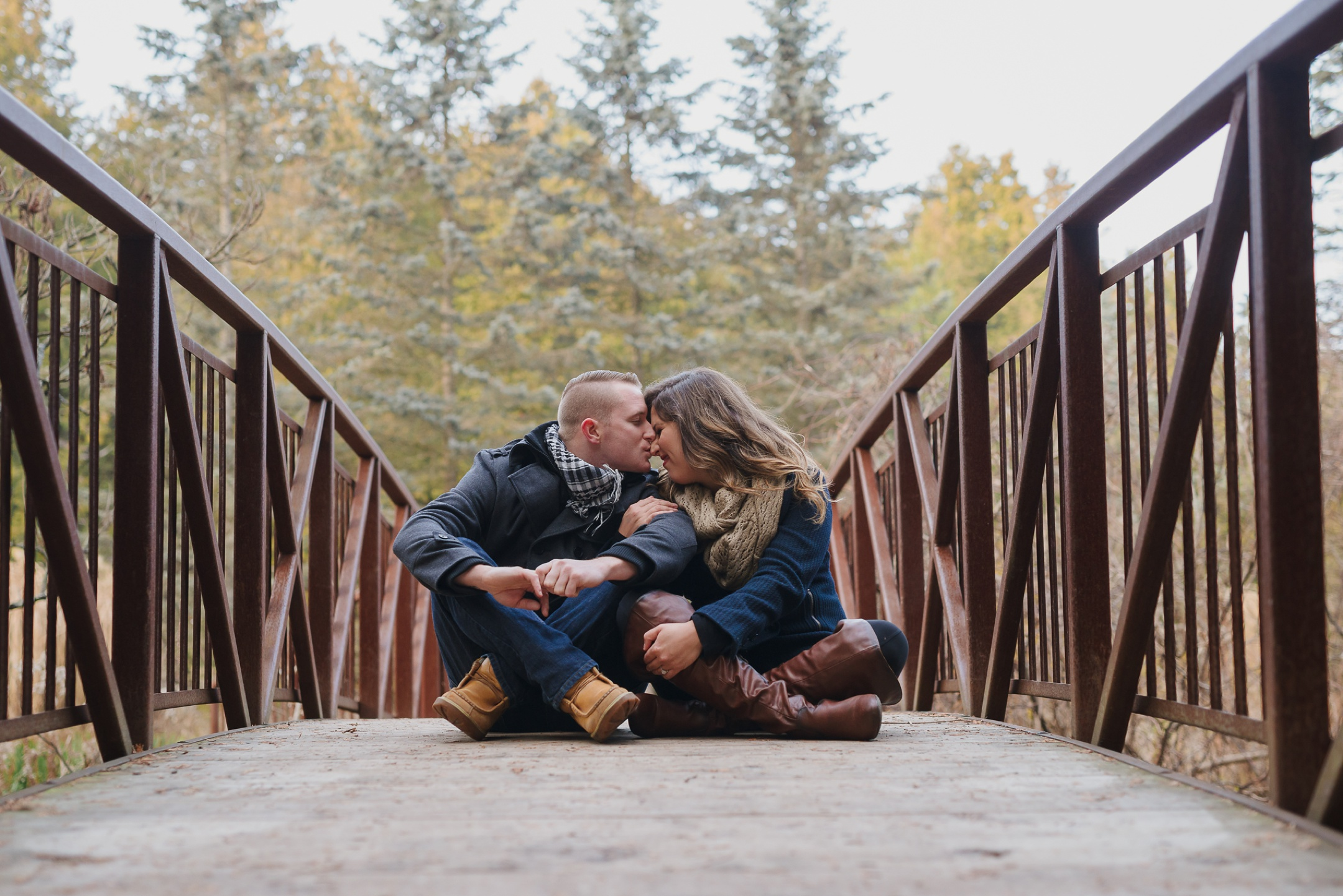 Durham Region, Whitby Engagement Session, couple sitting on a bridge