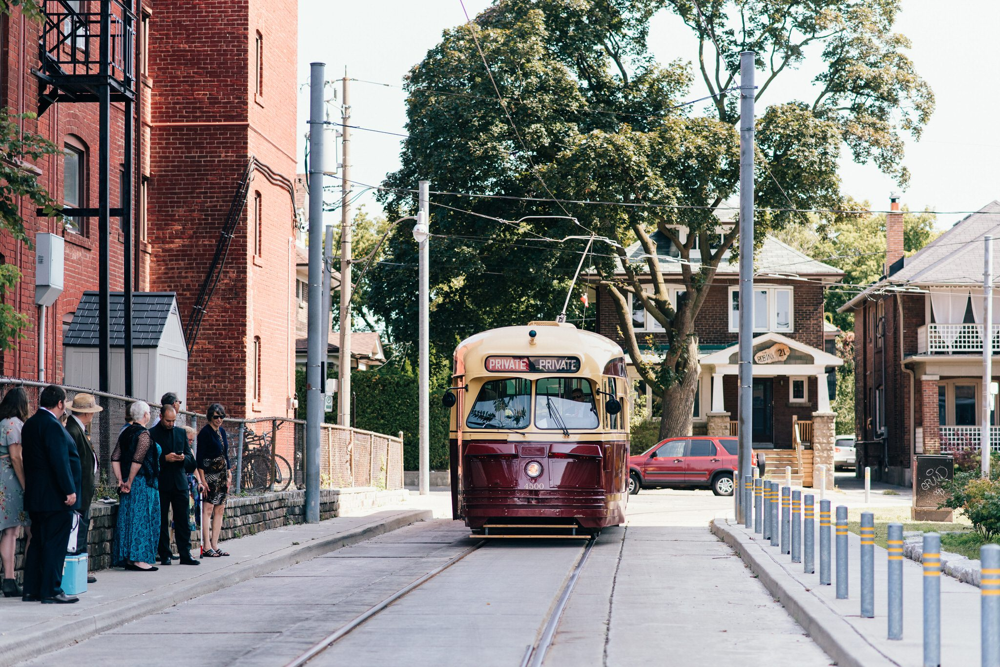 Guest wait to board a Vintage Toronto Streetcar Wedding