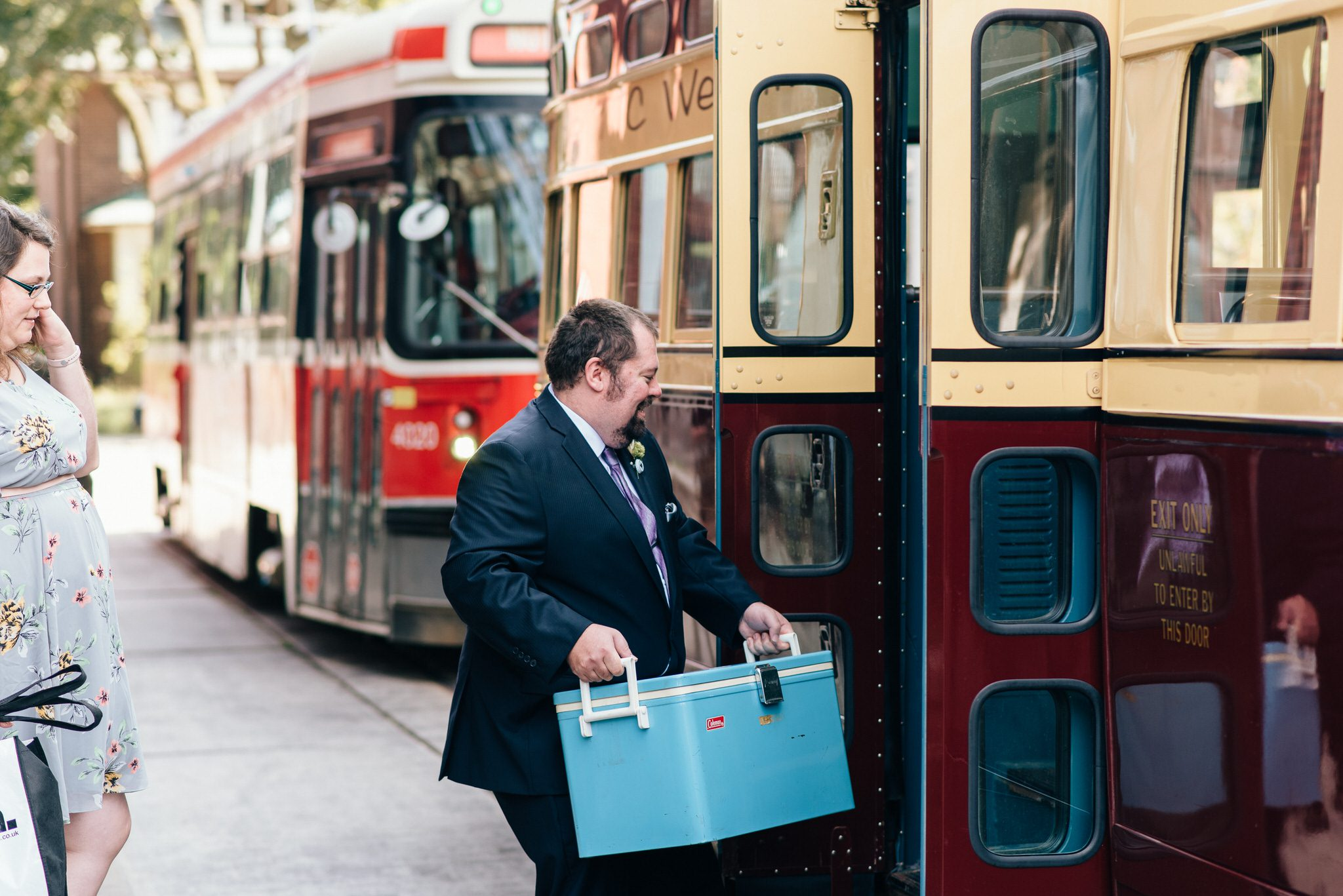 Guest bring a vintage blue cooler to a Vintage Toronto Streetcar Wedding Ceremony