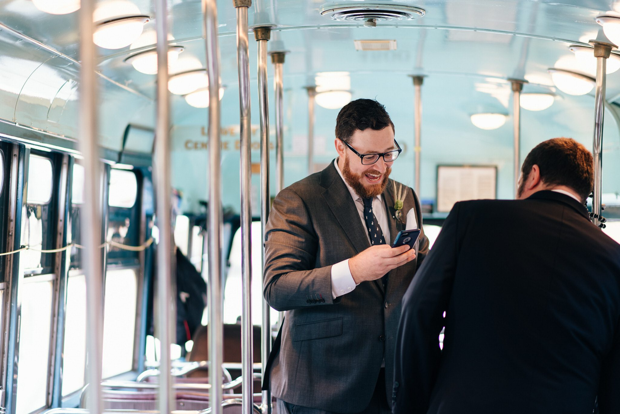 Groom smiles before his Toronto Streetcar Wedding