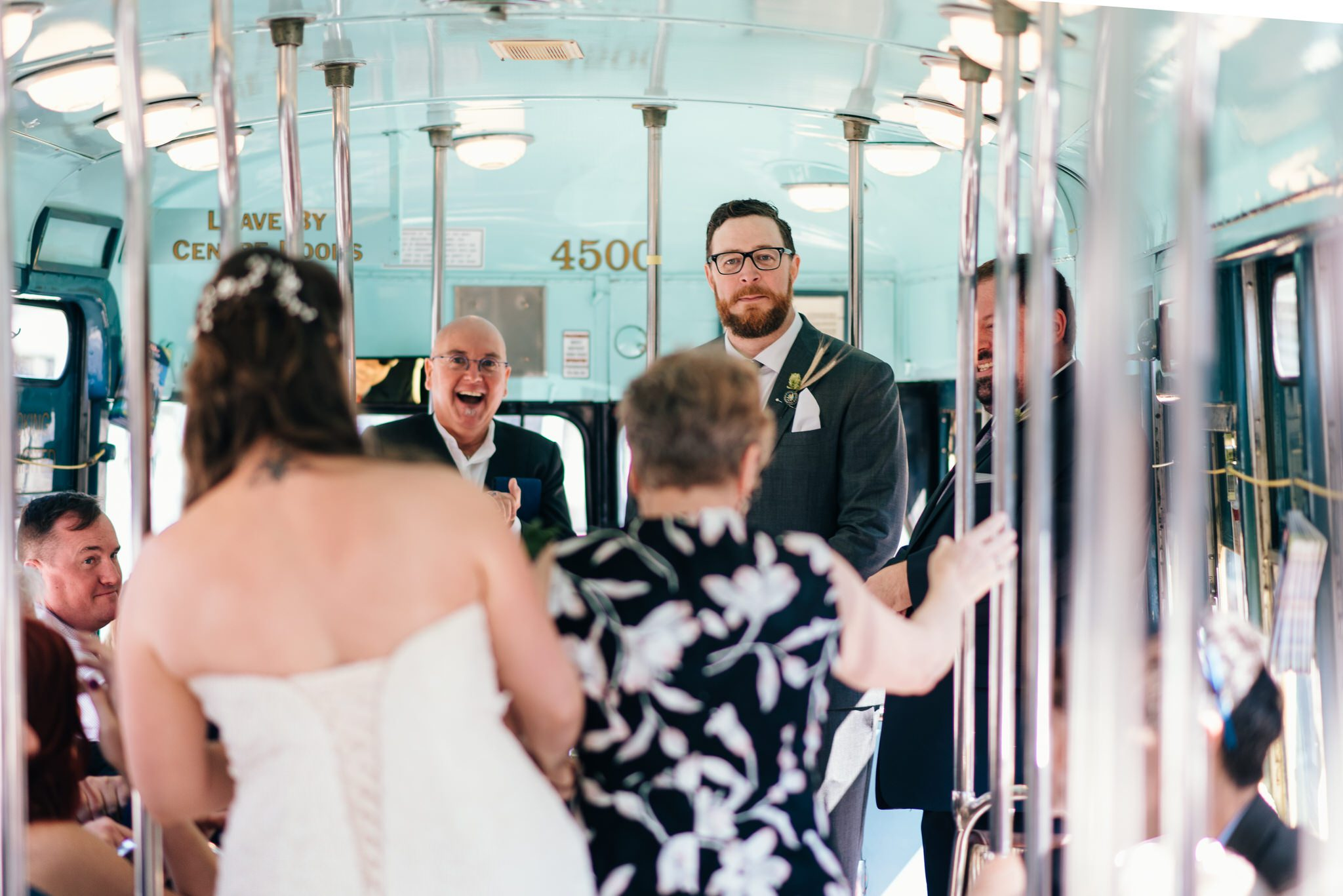 Grooms reaction to the bride during their Vintage Toronto Streetcar Wedding Ceremony