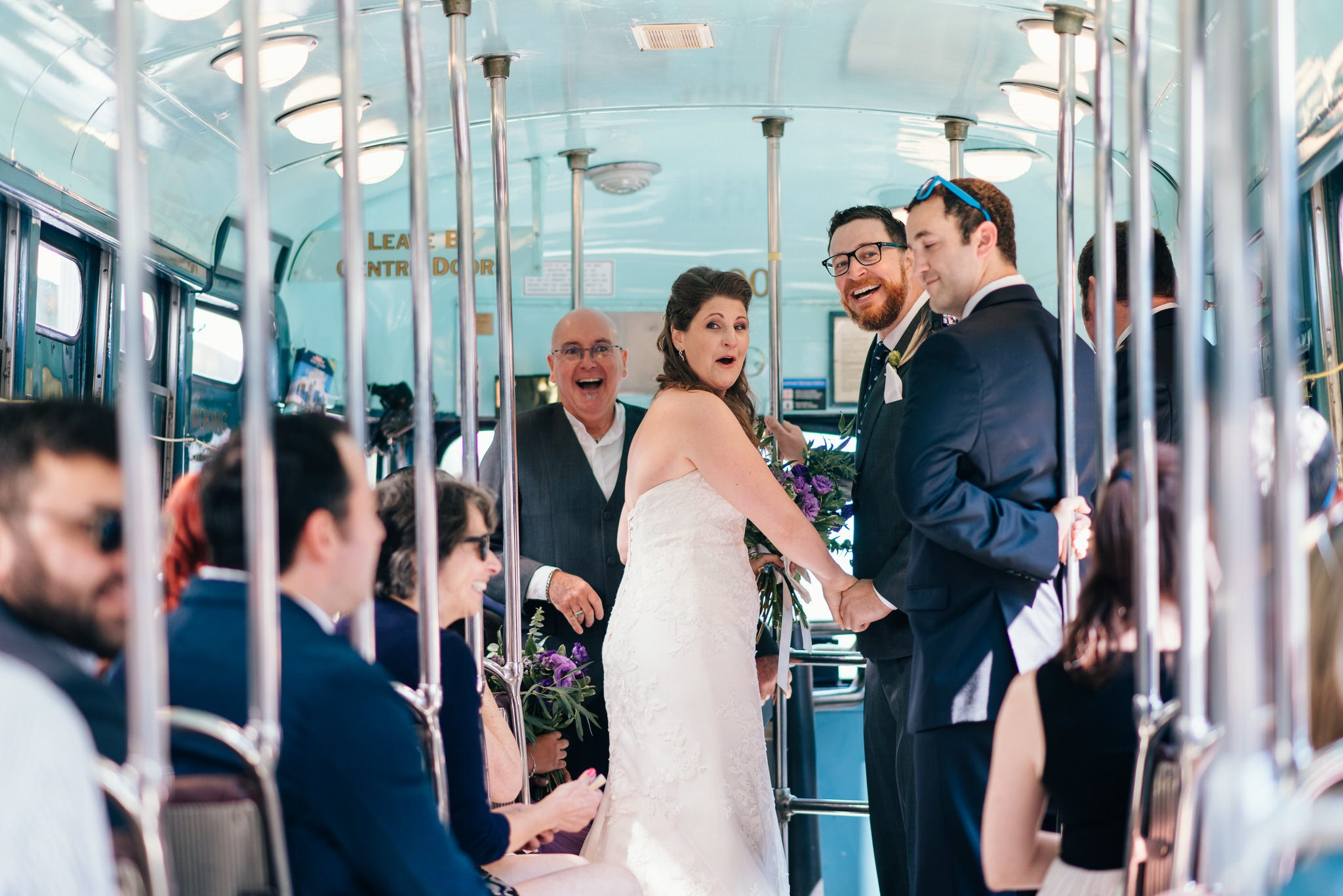 Everyone laughs during this Vintage Toronto Streetcar Wedding Ceremony