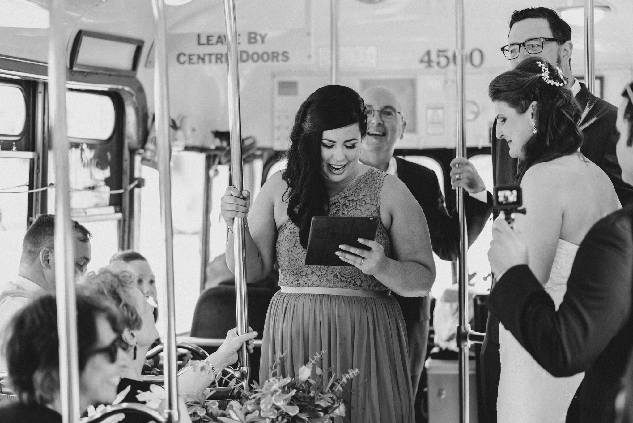 Black and white photo of the maid of honor's speech during their Vintage Toronto Streetcar Wedding Ceremony