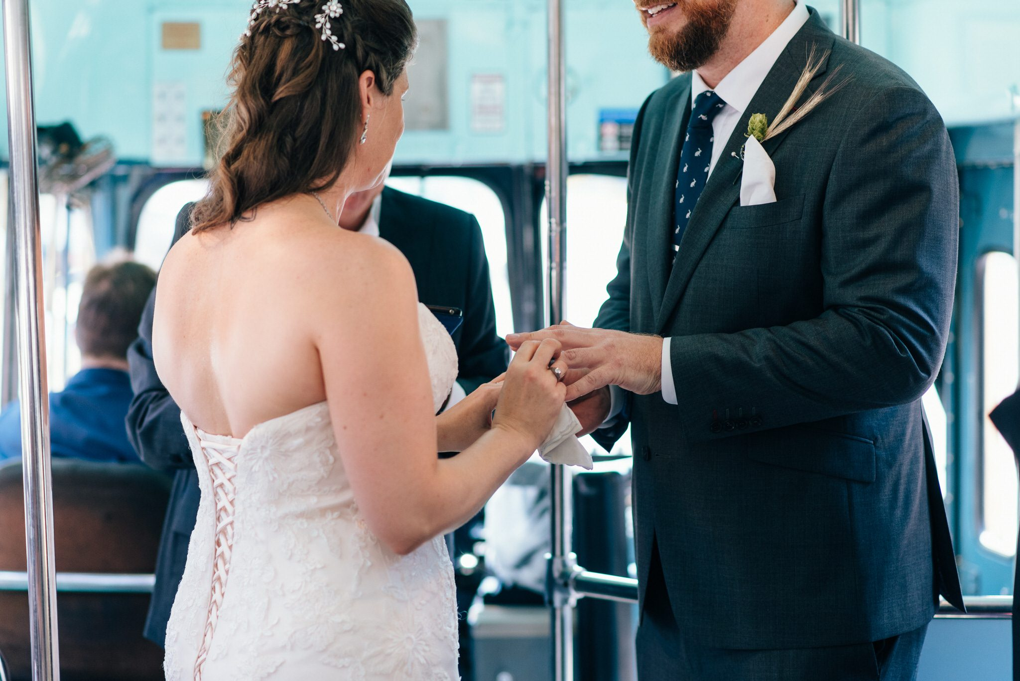 The bride and groom exchange rings during their Vintage Toronto Streetcar Wedding Ceremony