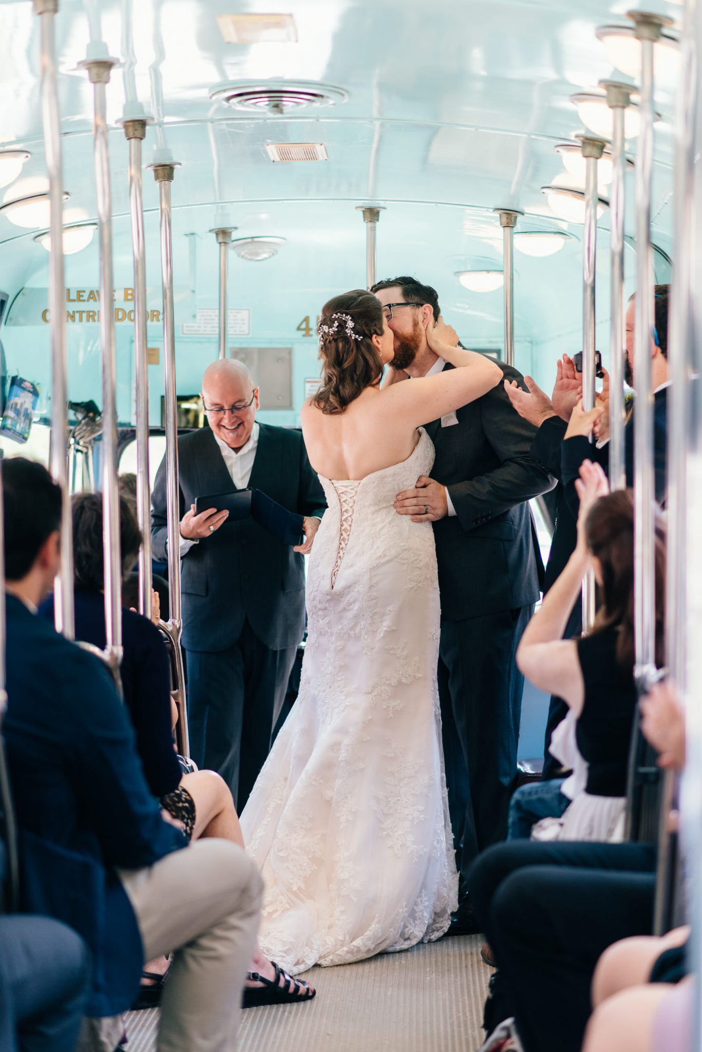 The bride and groom kiss at the end of their Vintage Toronto Streetcar Wedding Ceremony