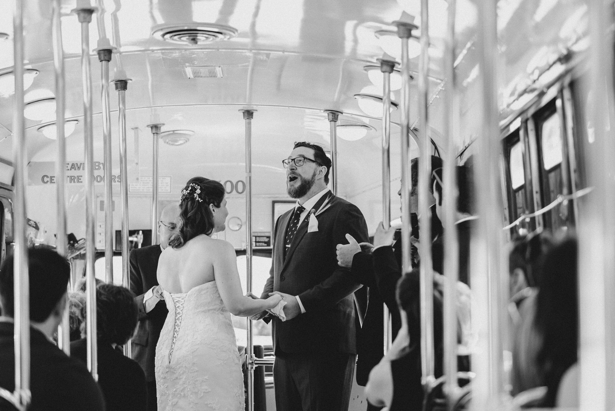 The grooms reaction after their Vintage Toronto Streetcar Wedding Ceremony