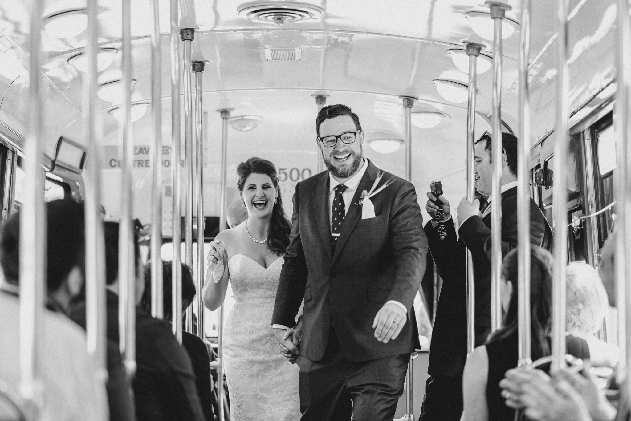 The bride and groom walk down the aisle after their Vintage Toronto Streetcar Wedding Ceremony