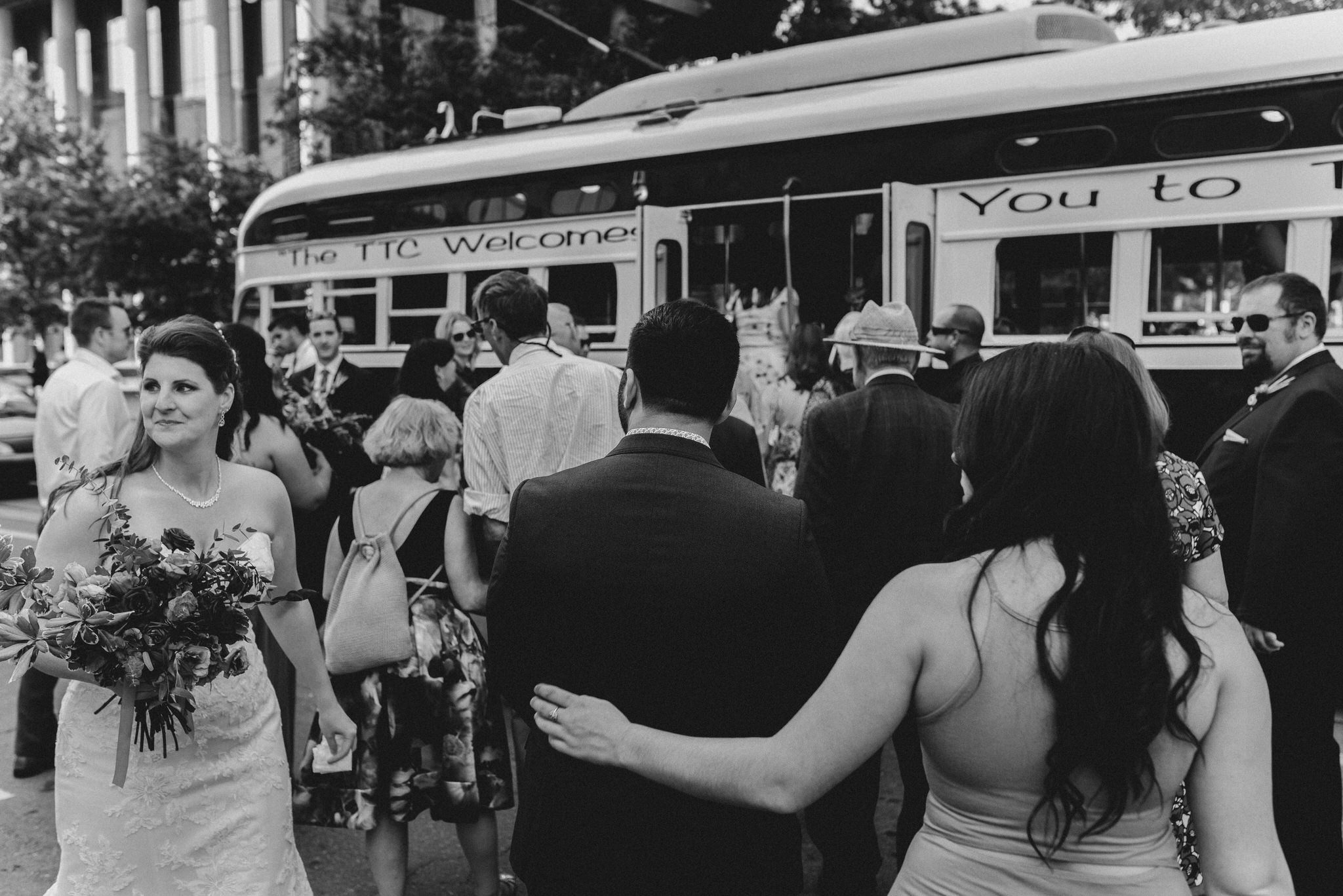 Wedding guests board a Vintage Toronto Streetcar on college.