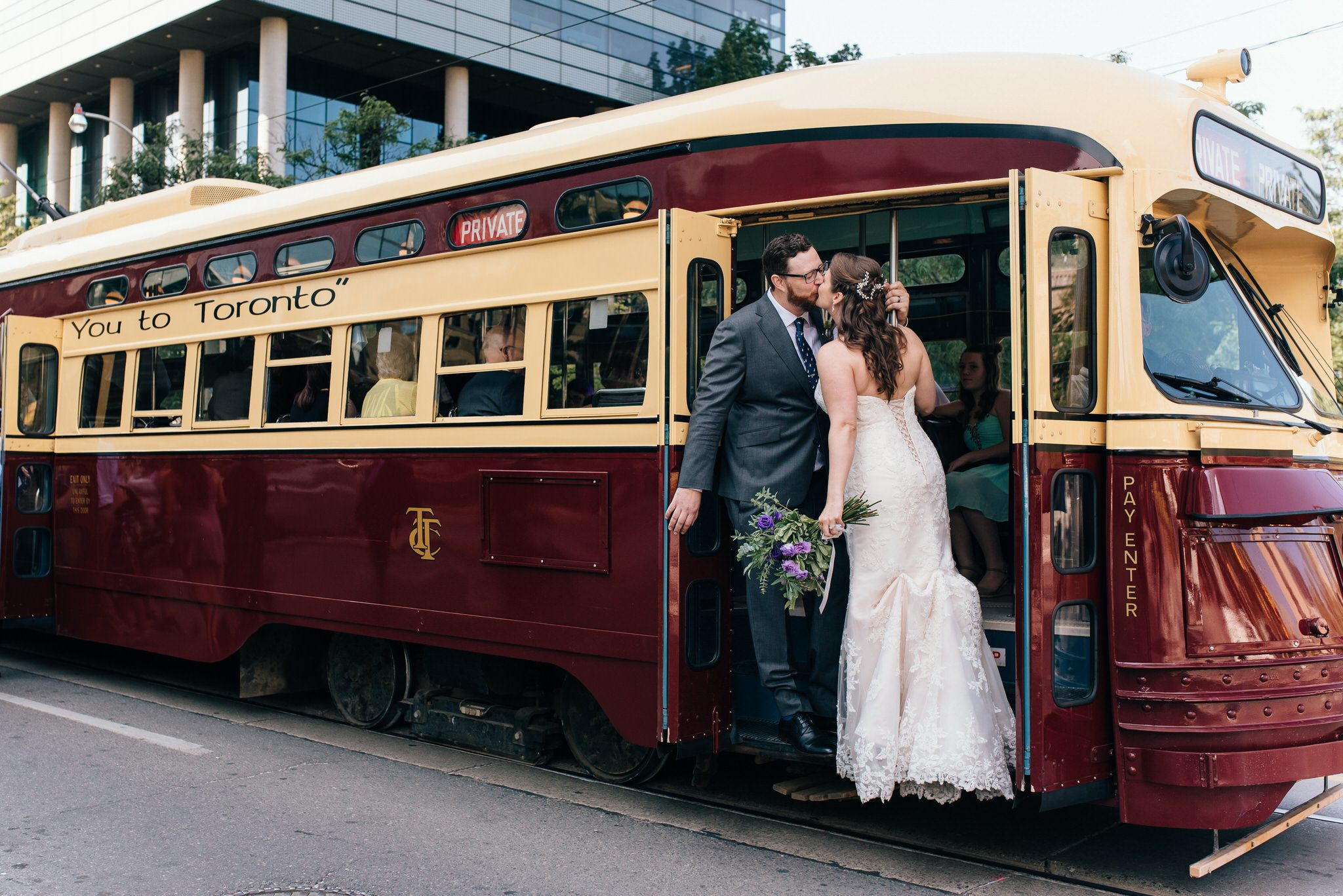Newlyweds kiss on steps of Vintage Toronto Streetcar