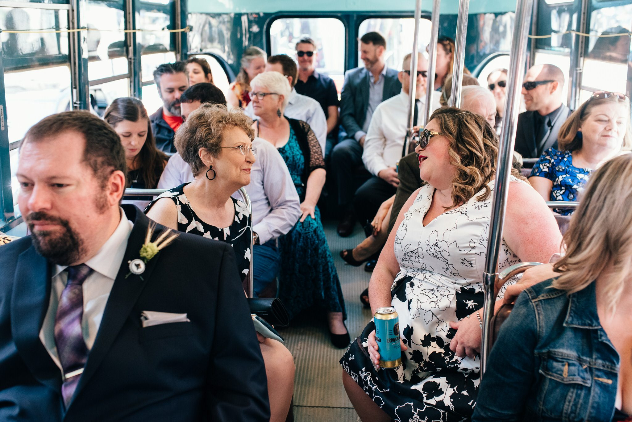 Guests chat on board after a Vintage Toronto Streetcar Wedding
