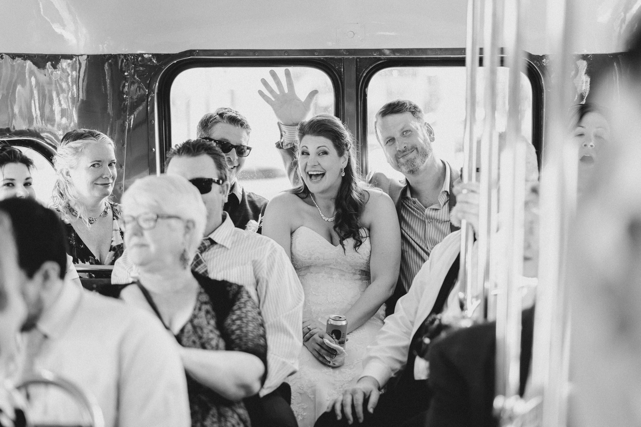 The bride smiles with guests on board after her Vintage Toronto Streetcar Wedding