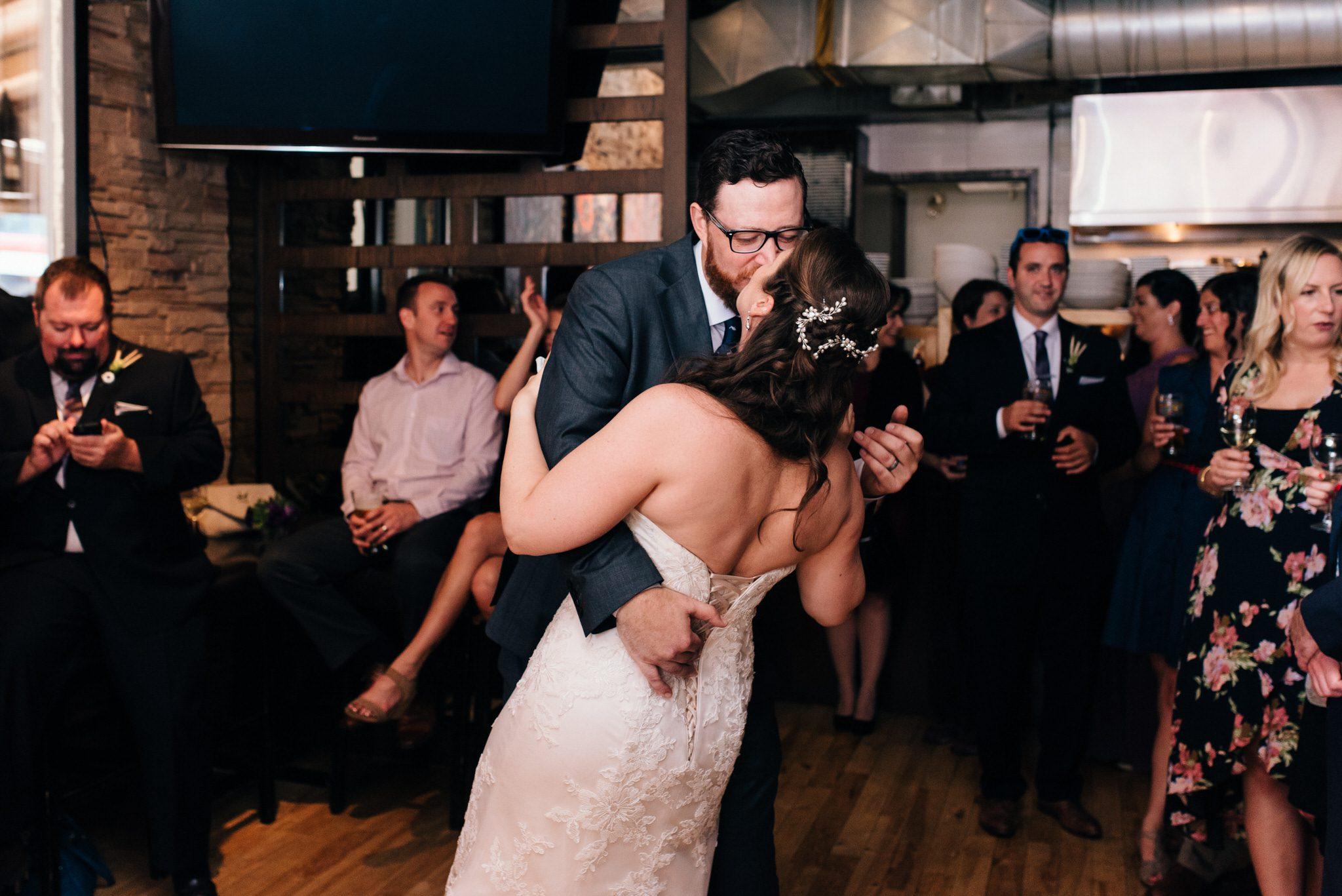 The bride and groom's first dance ends with a kiss at The Rushton Restaurant for their wedding reception.