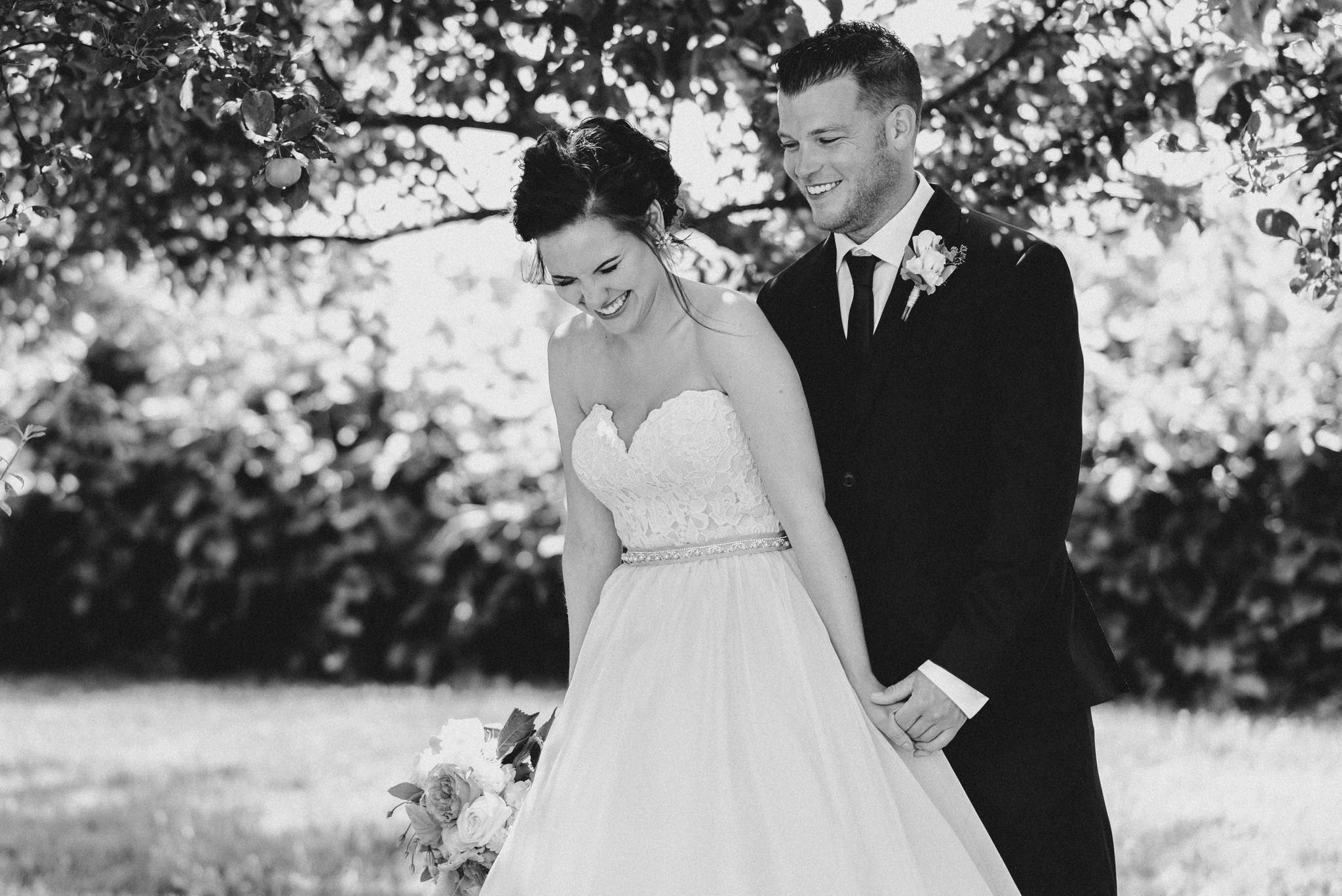 Bloomfield Gardens Wedding - bride and groom laughing in gardens