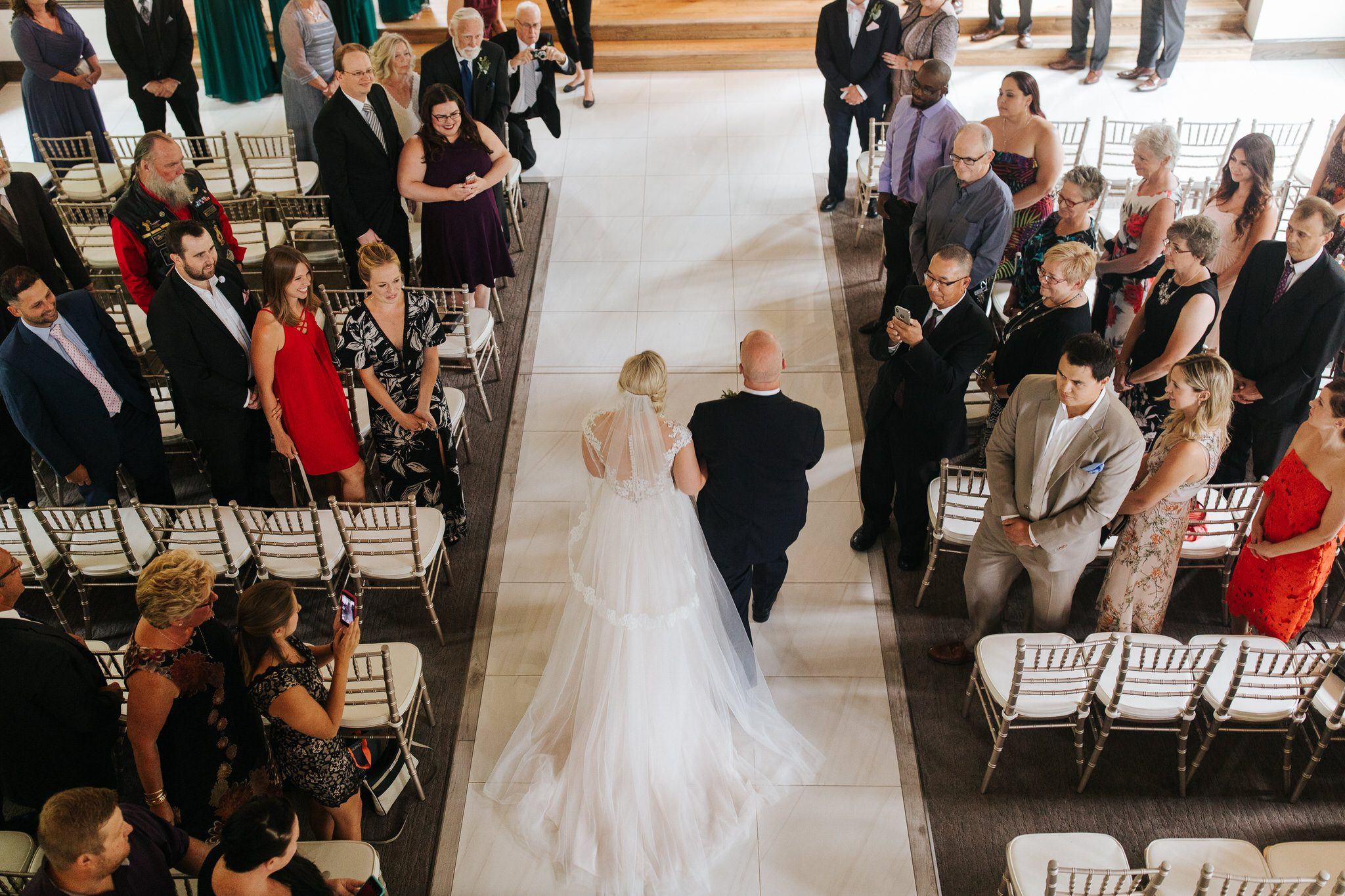 Ancaster Mill Wedding - bride and father walk down aisle