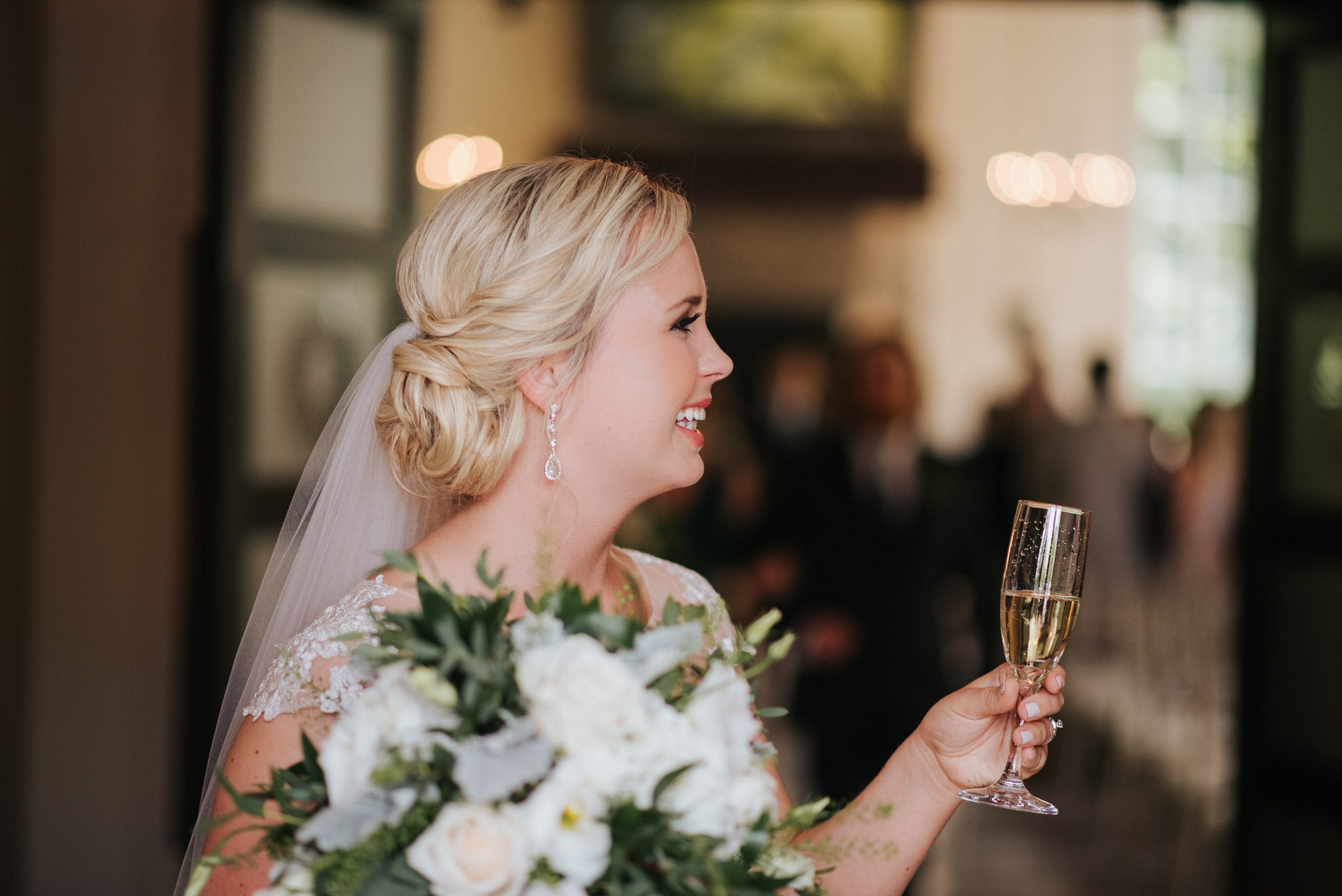 Ancaster Mill Wedding - bride with champagne