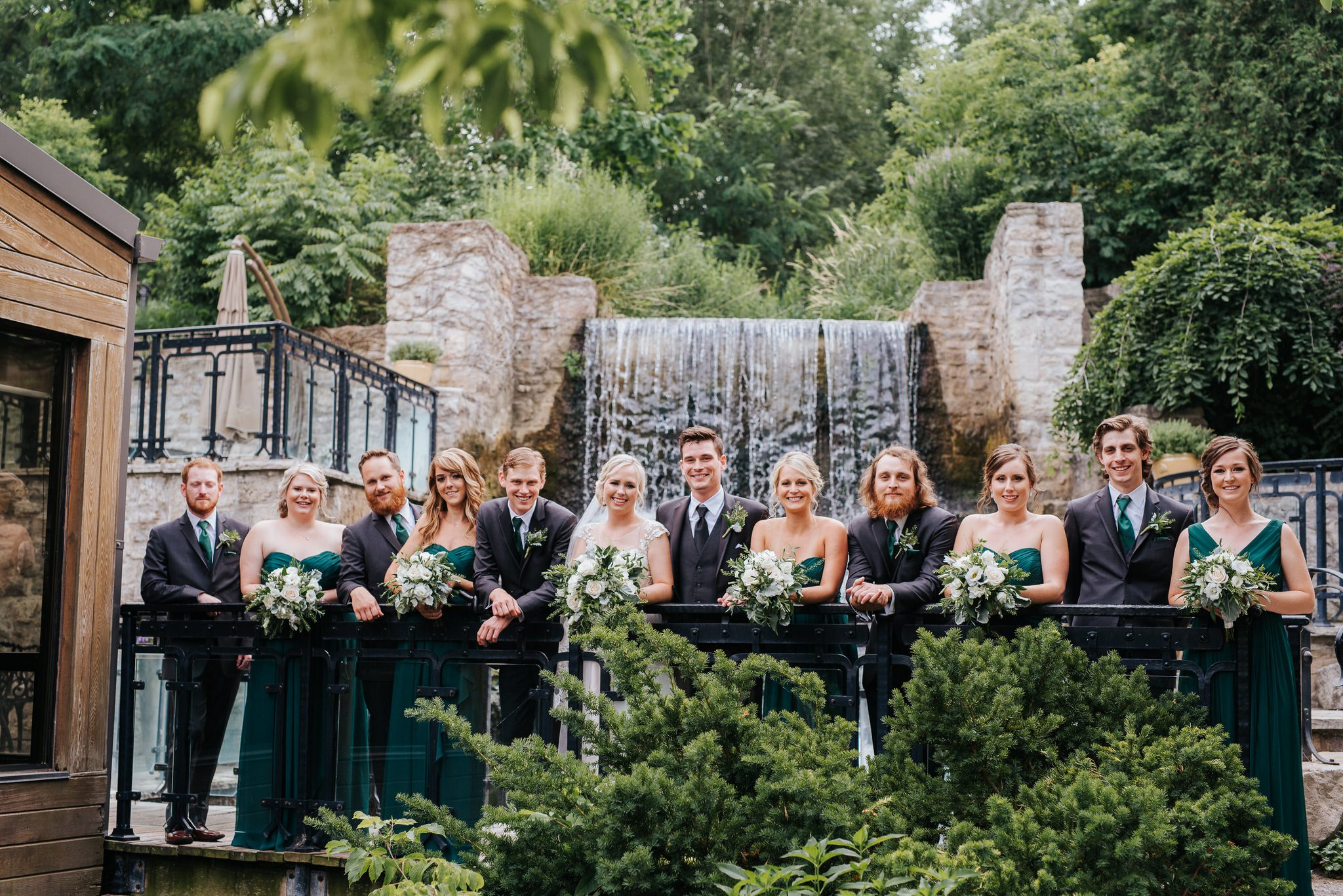 Ancaster Mill Wedding - wedding party at waterfall