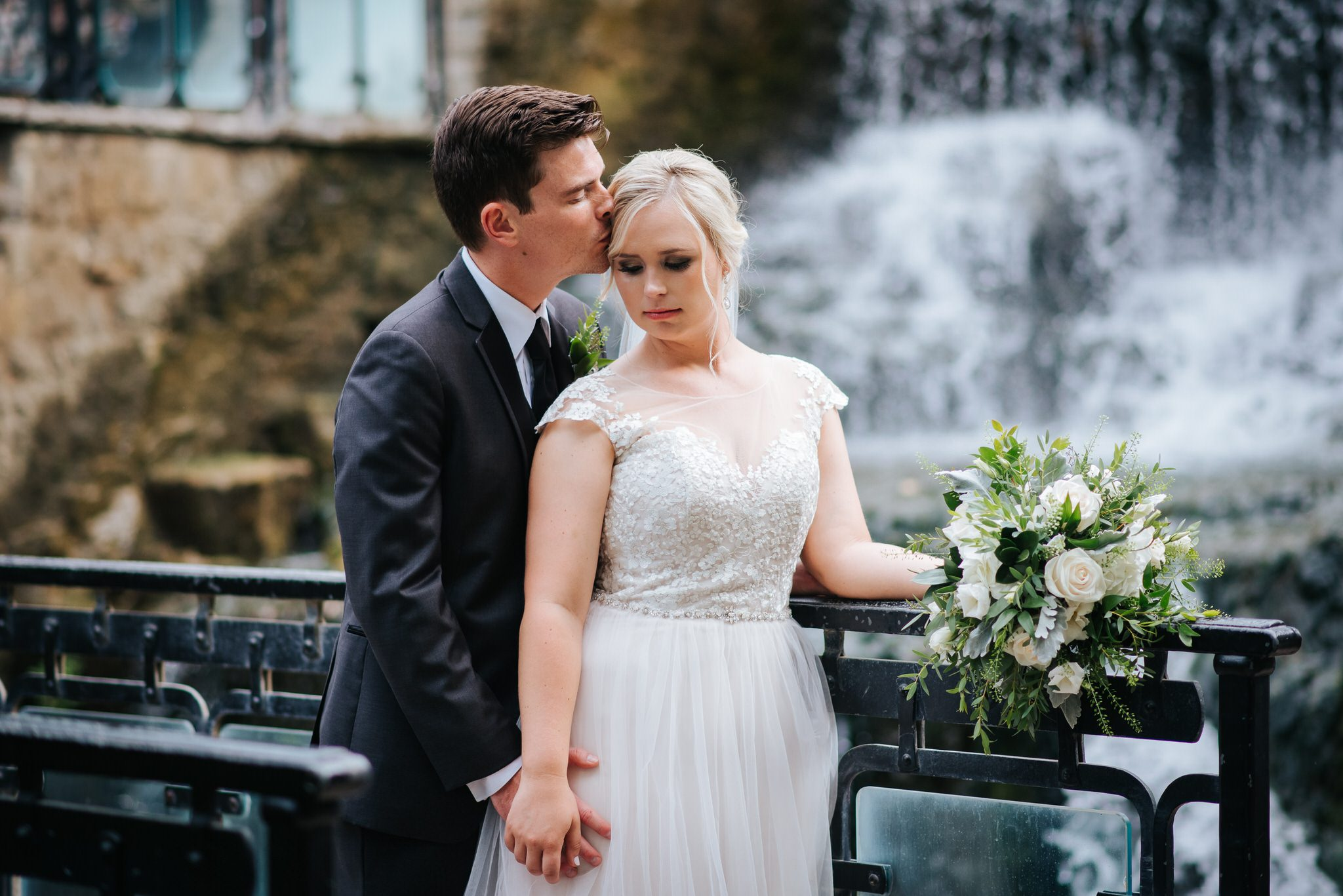 Ancaster Mill Wedding - kissing at the waterfall