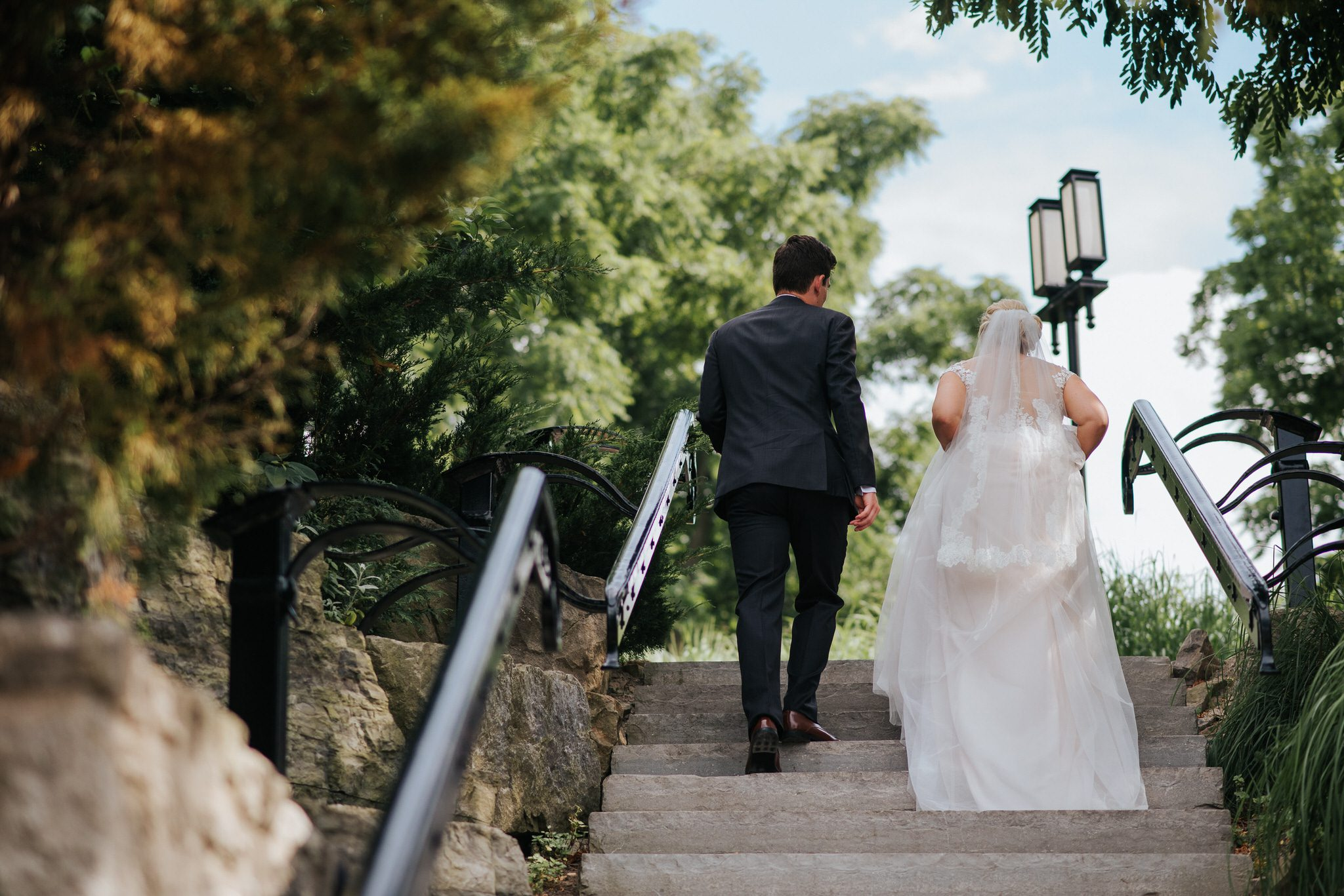 Ancaster Mill Wedding - bride and groom on the stairs