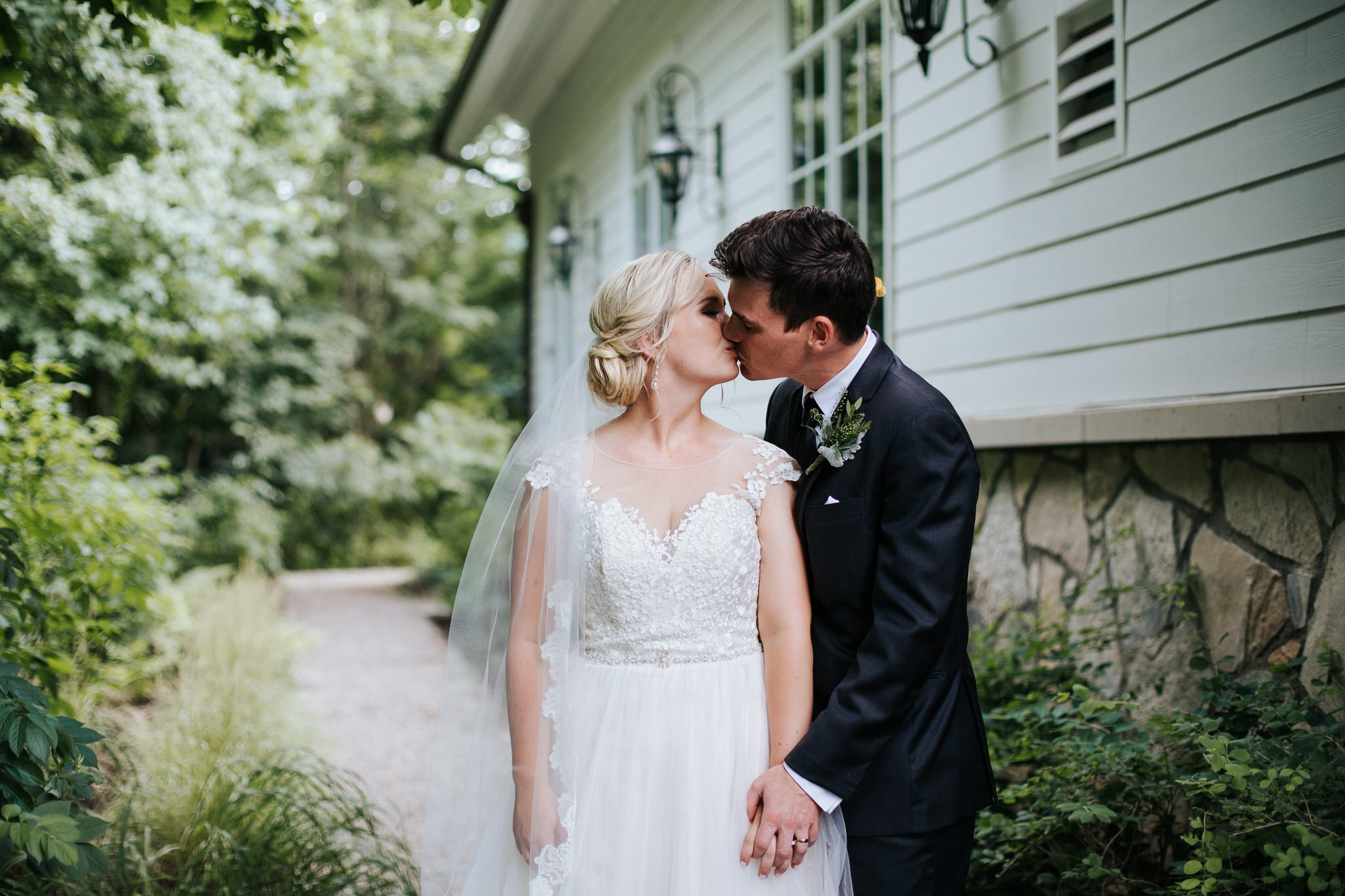 Ancaster Mill Wedding - bride and groom kissing