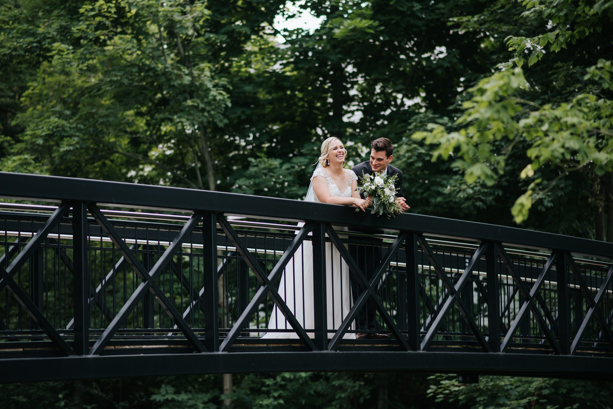 Ancaster Mill Wedding - bride and groom on bridge