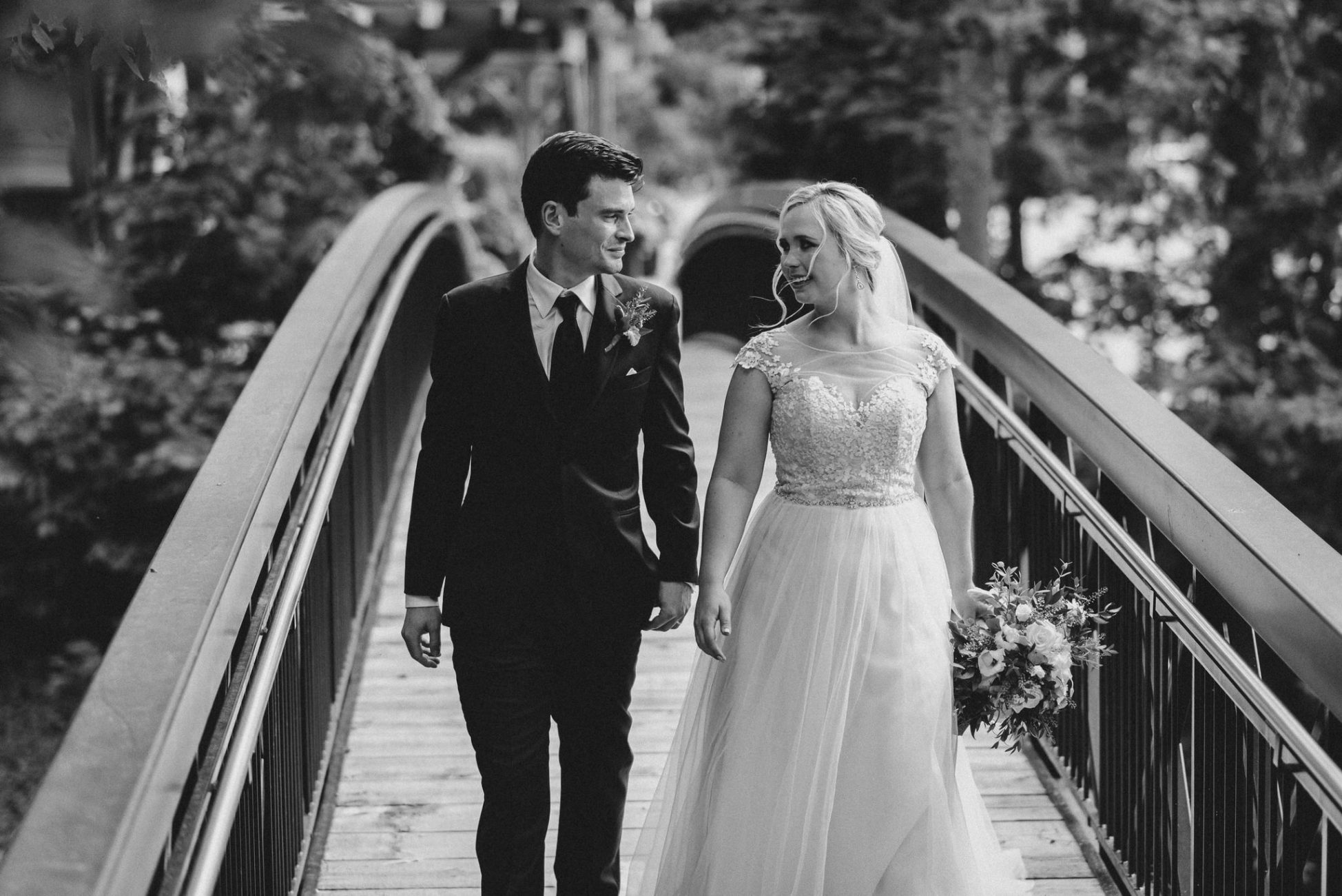 Ancaster Mill Wedding - bride and groom crossing bridge