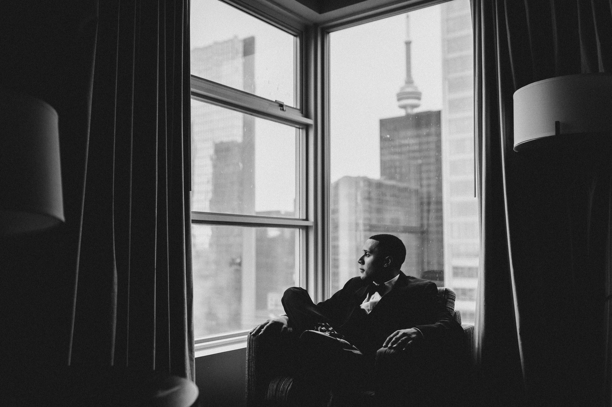 One King Toronto New Years Eve Wedding - groom in chair with skyline