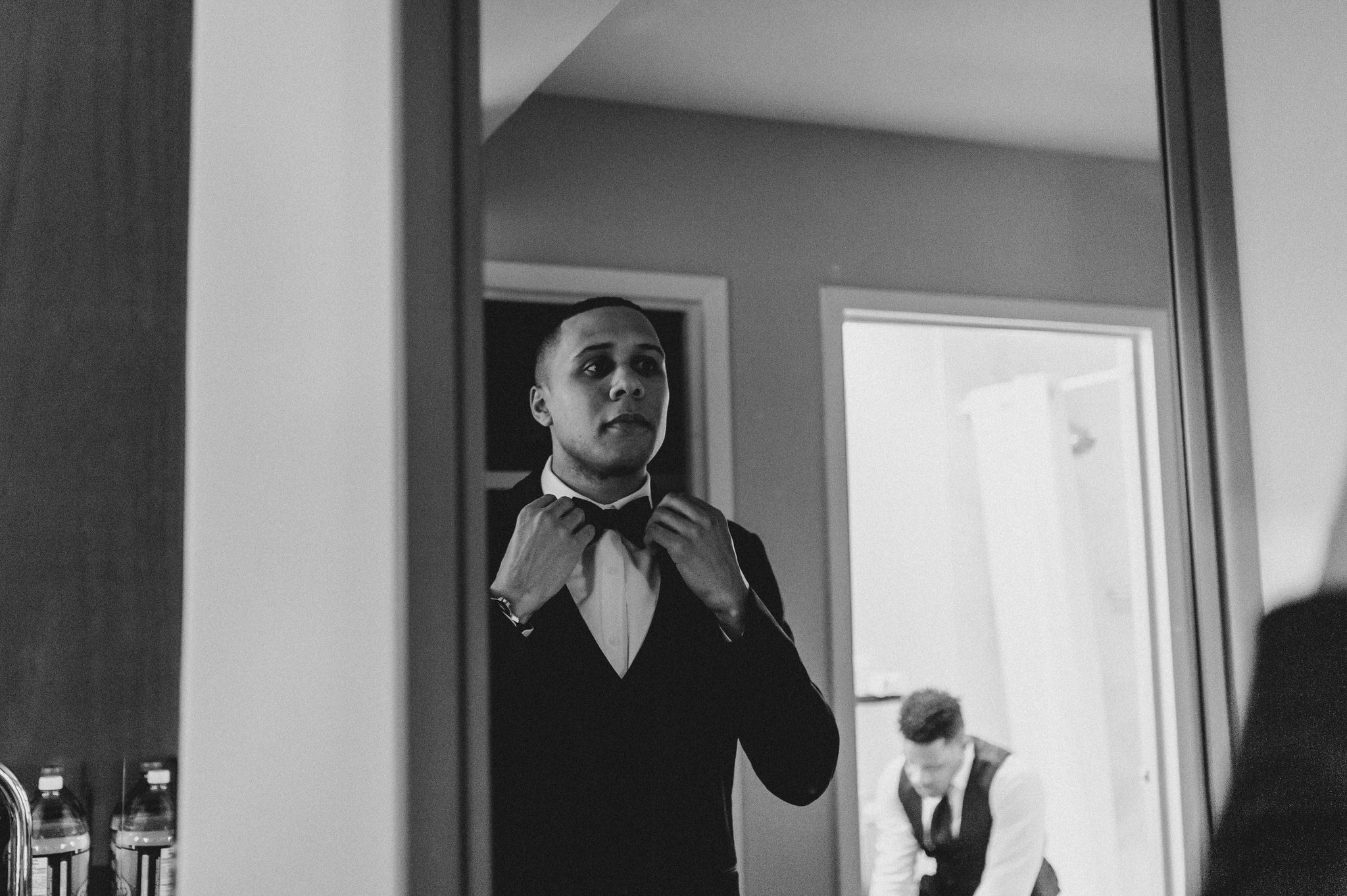 One King Toronto New Years Eve Wedding - groom adjusting bowtie