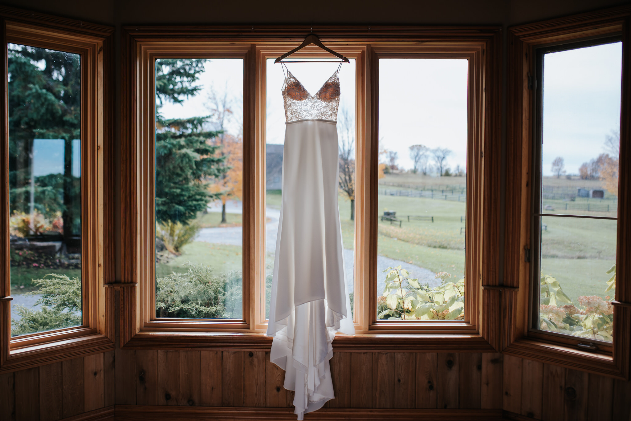 Waterstone Estate & Farms Wedding - Wedding Dress in Window