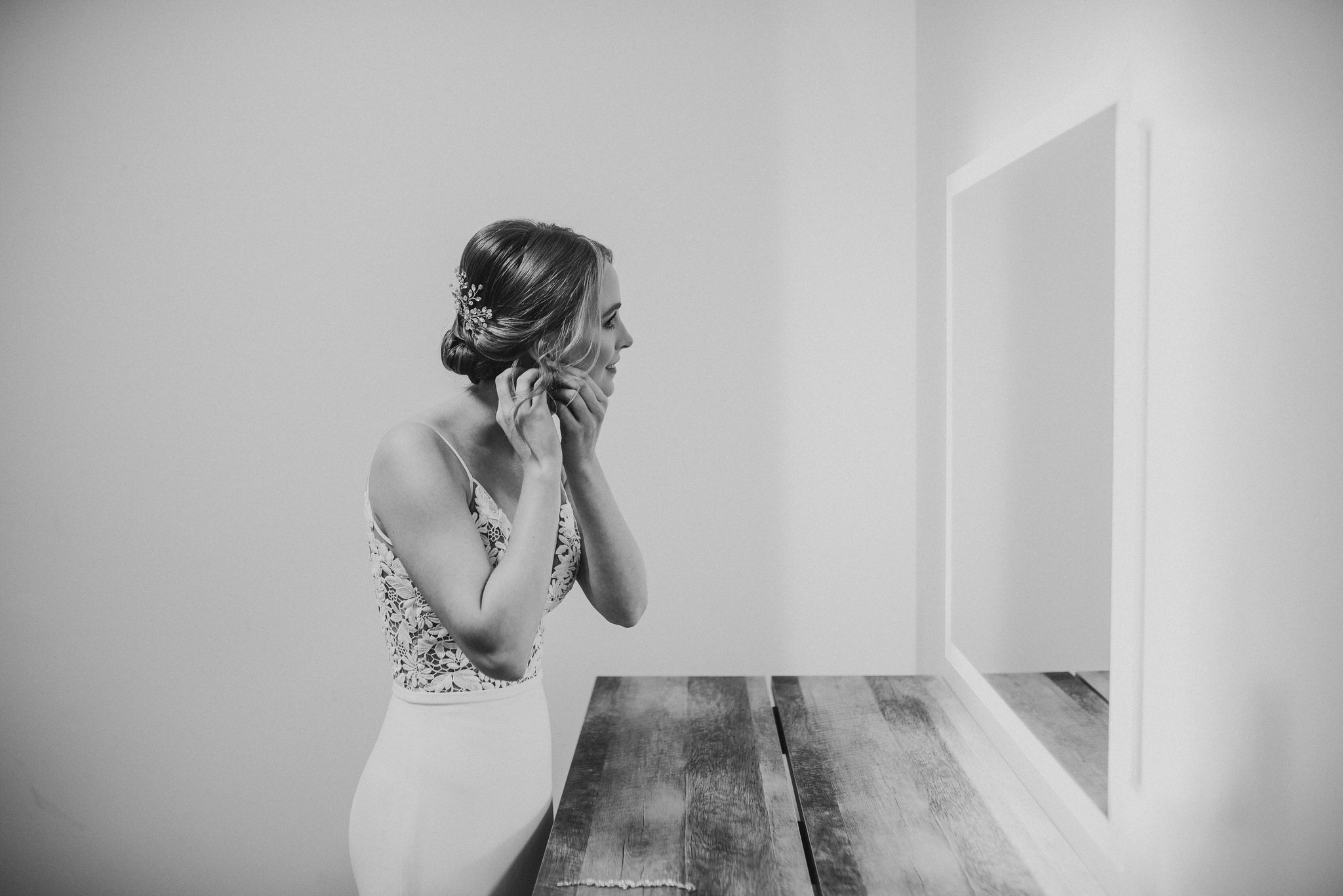 Waterstone Estate & Farms Wedding - bride looking in mirror