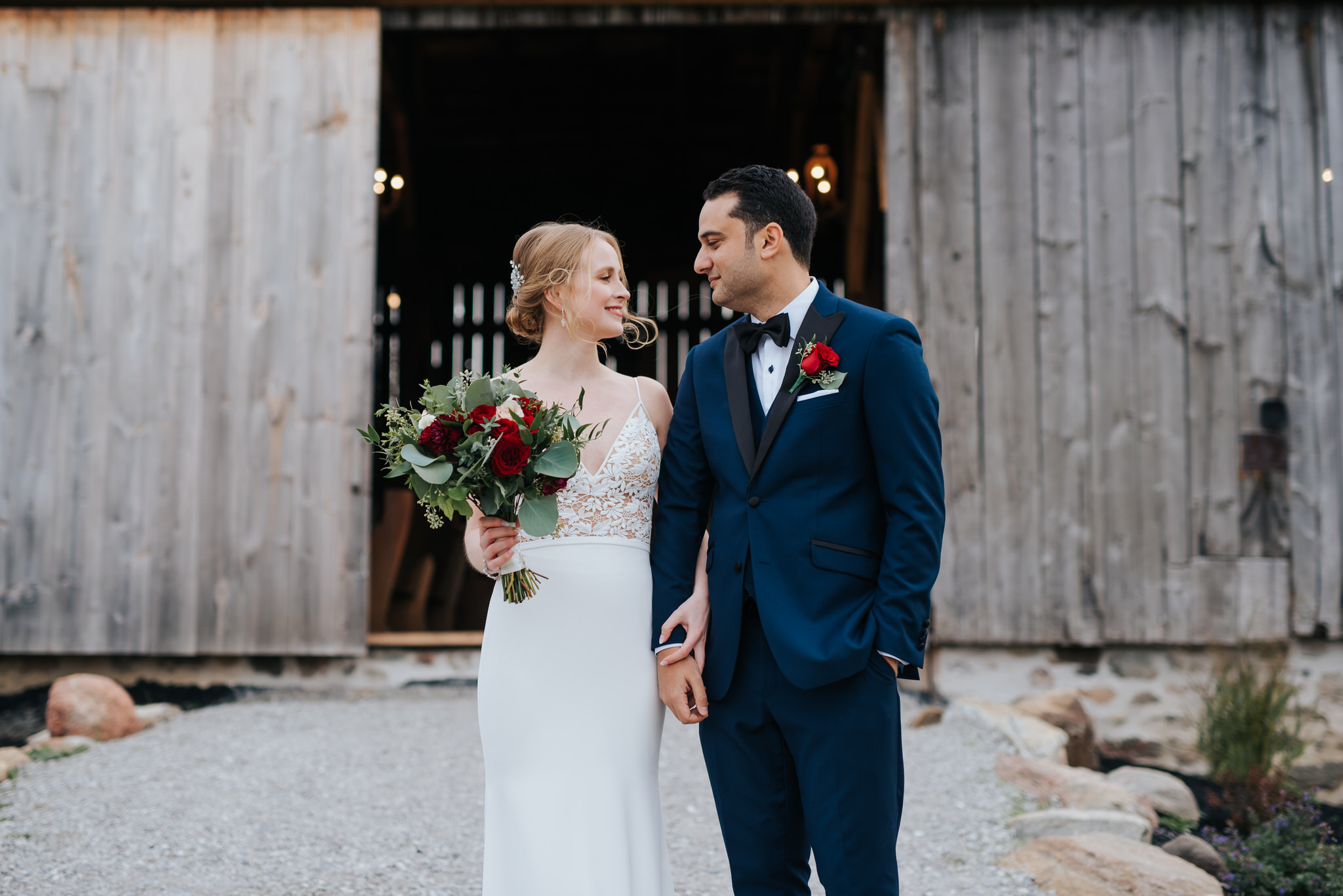 Waterstone Estate & Farms Wedding - bride and groom outside barn